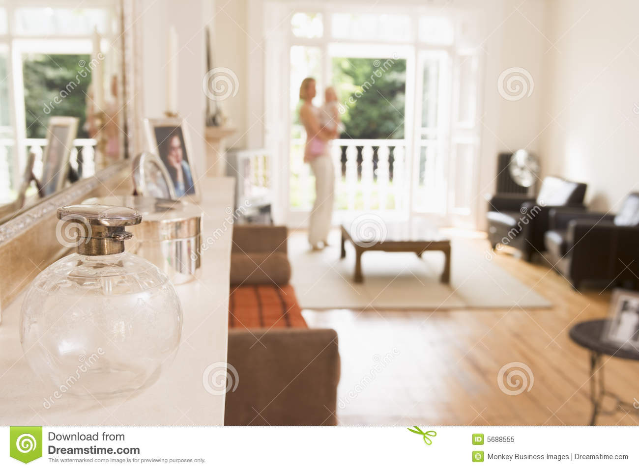 Woman Standing In Living Room Holding Baby Royalty Free
