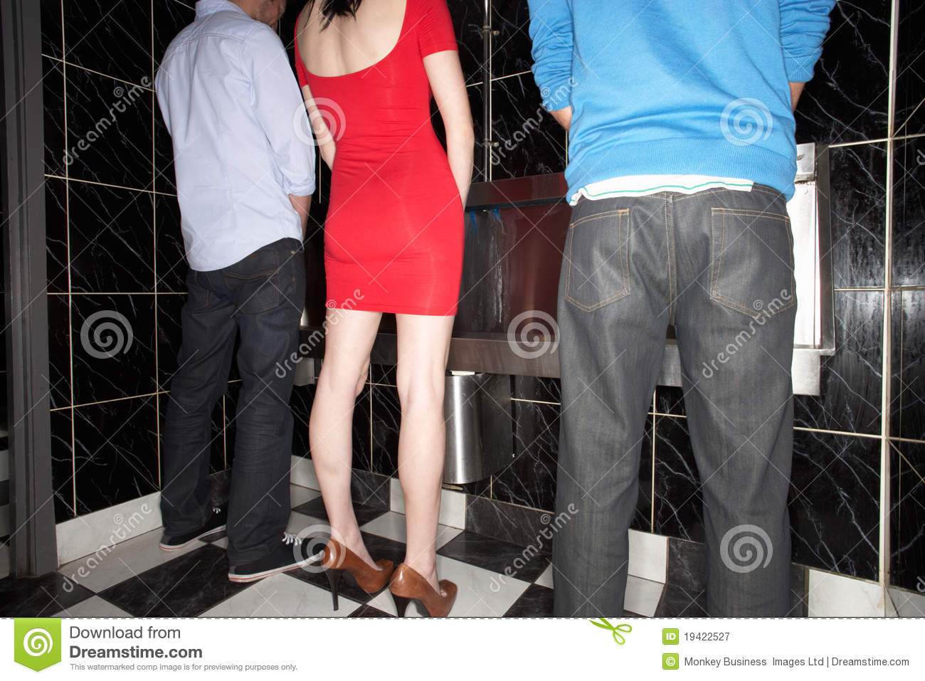 Woman And Two Men Standing At Mens Urinal Stock Image