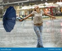 Woman With Umbrella Enjoying In Rain Stock
