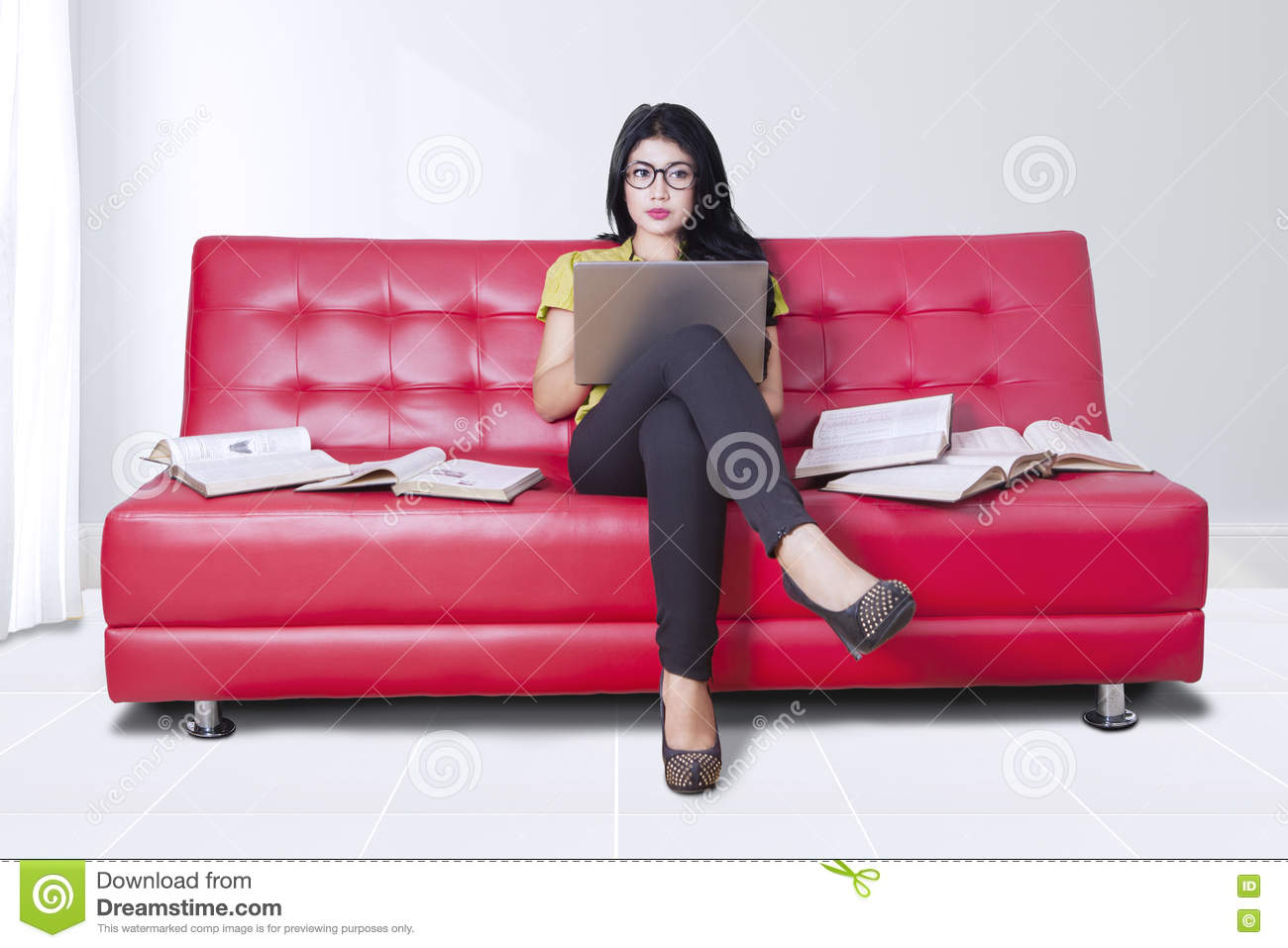 sitting pretty sofas sofa e colchoes sp woman uses laptop with books on stock image