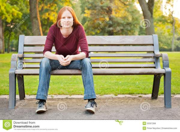 Woman Waiting Bench In Park Stock