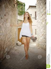 Woman Walking Barefoot In Street Stock