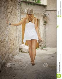 Woman Walking Barefoot In Street Royalty Free Stock
