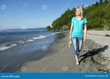 Woman Walking Beach Stock - 31037292