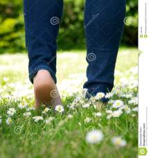 Woman Walking Barefoot in Grass