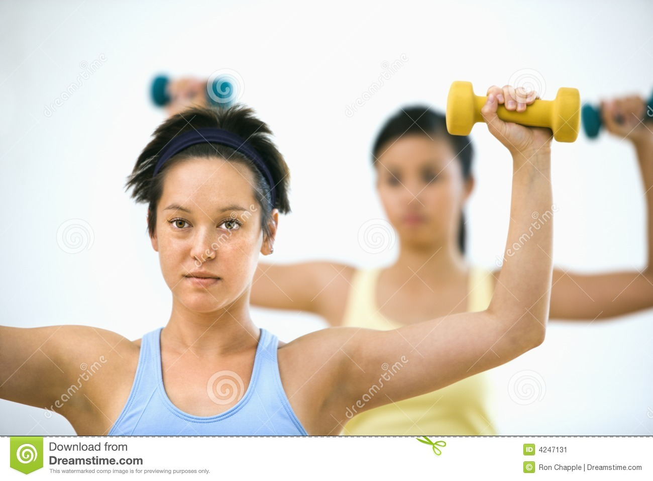 woman lifting weights hand