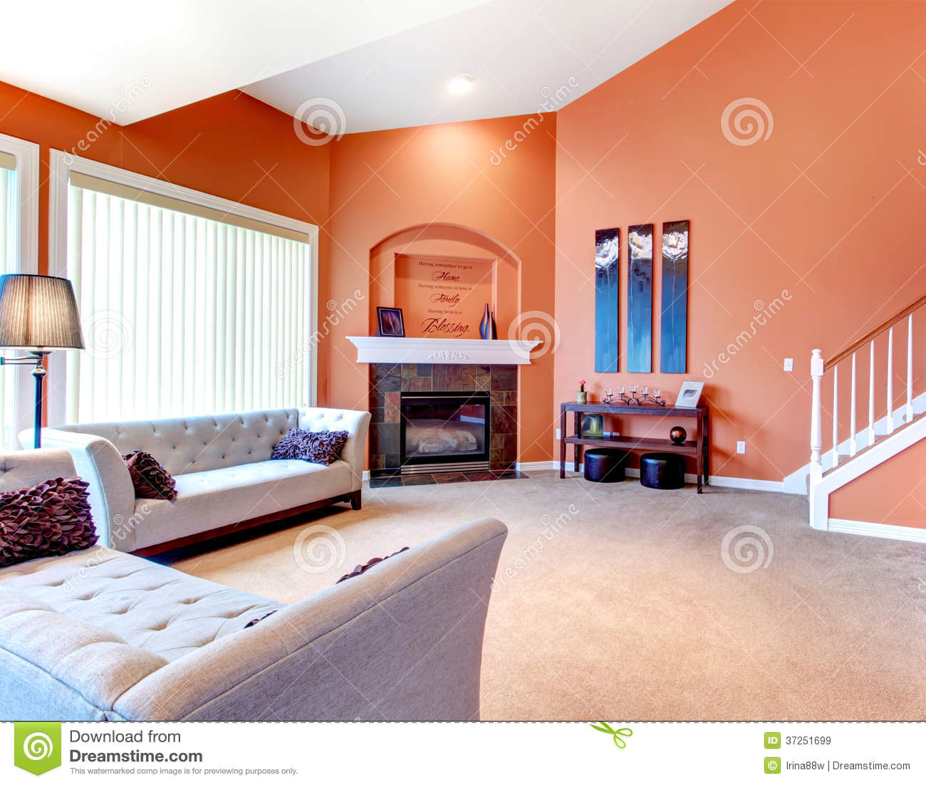 grey white orange living room beige carpet wonderful with classic sofa dark stoned cozy floor wood stairs furniture and fireplace decorated table candles wall handmade art