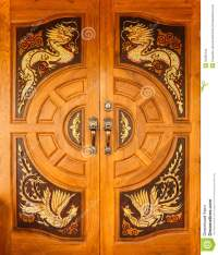 Wood Door With Dragons And Swans Design Stock Photo ...