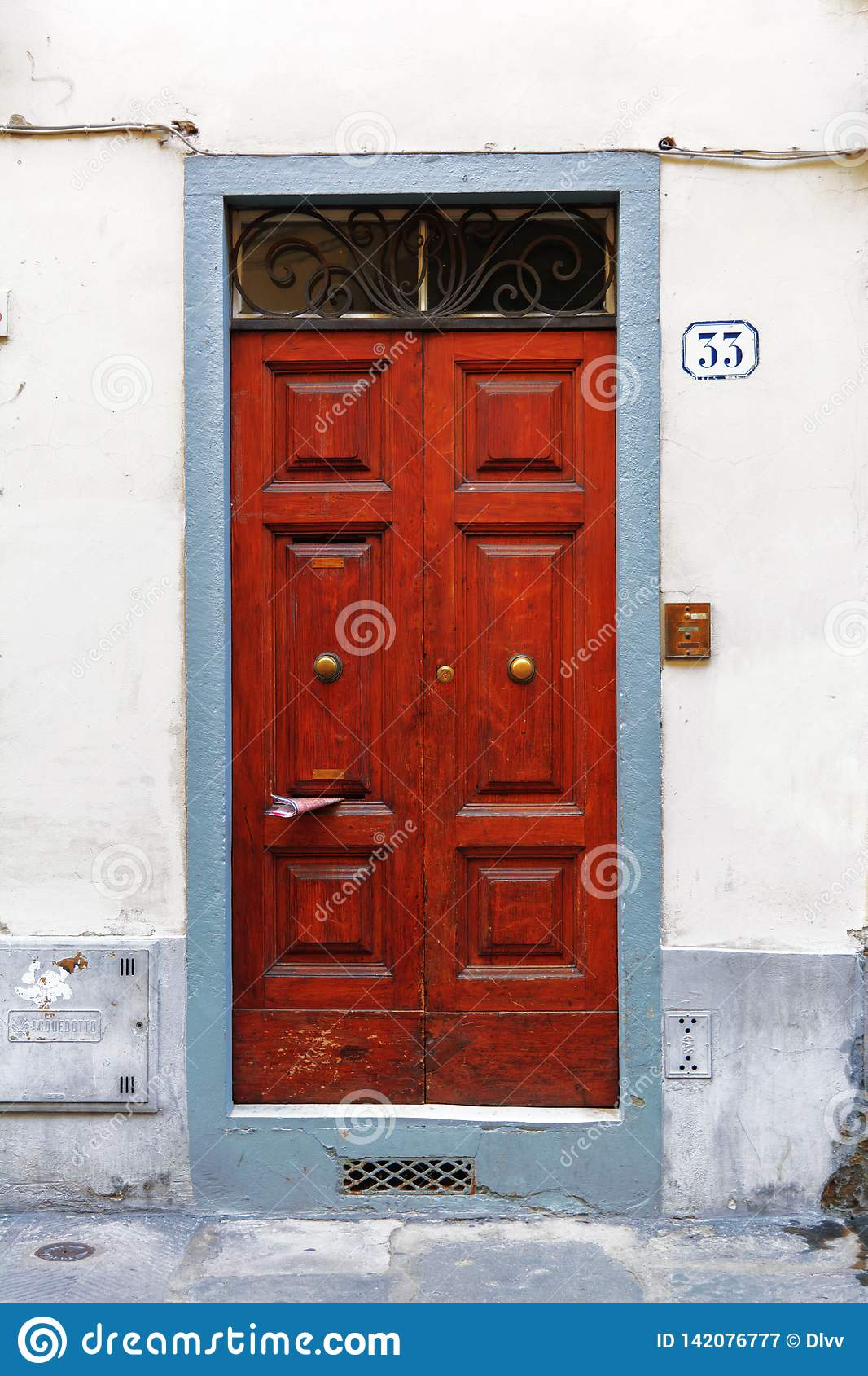 Wood Front Door With A Magazine In A Letterbox Editorial