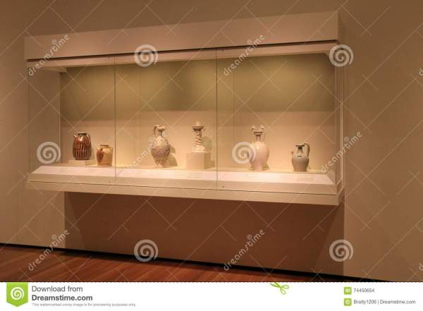 Wood And Glass Cabinet With Exhibit Of Historic Pottery