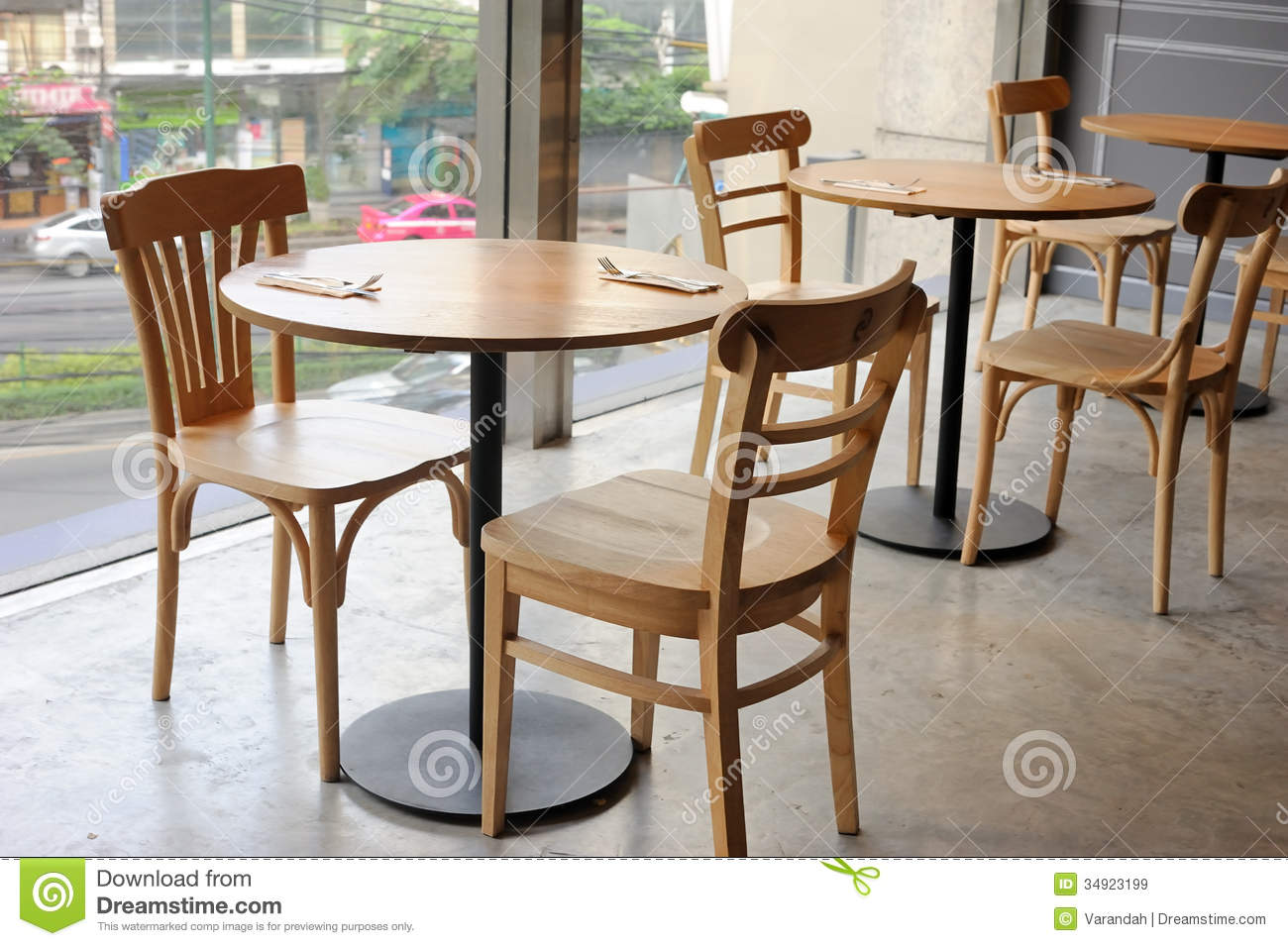 Wooden Chair And Table In Cafe Near Glass Wall Stock Image