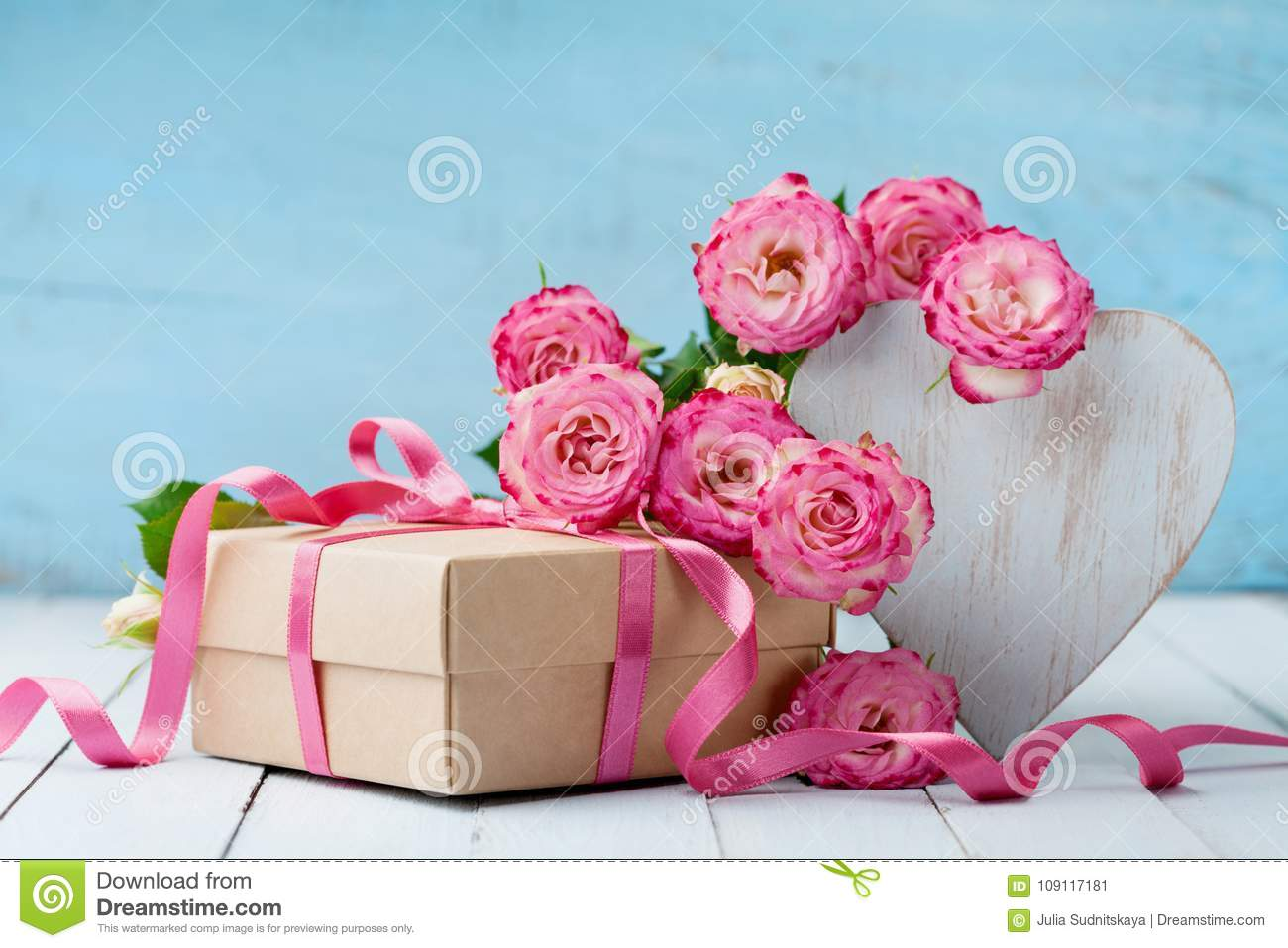 Wooden Heart Pink Rose Flowers And Gift Box On Turquoise