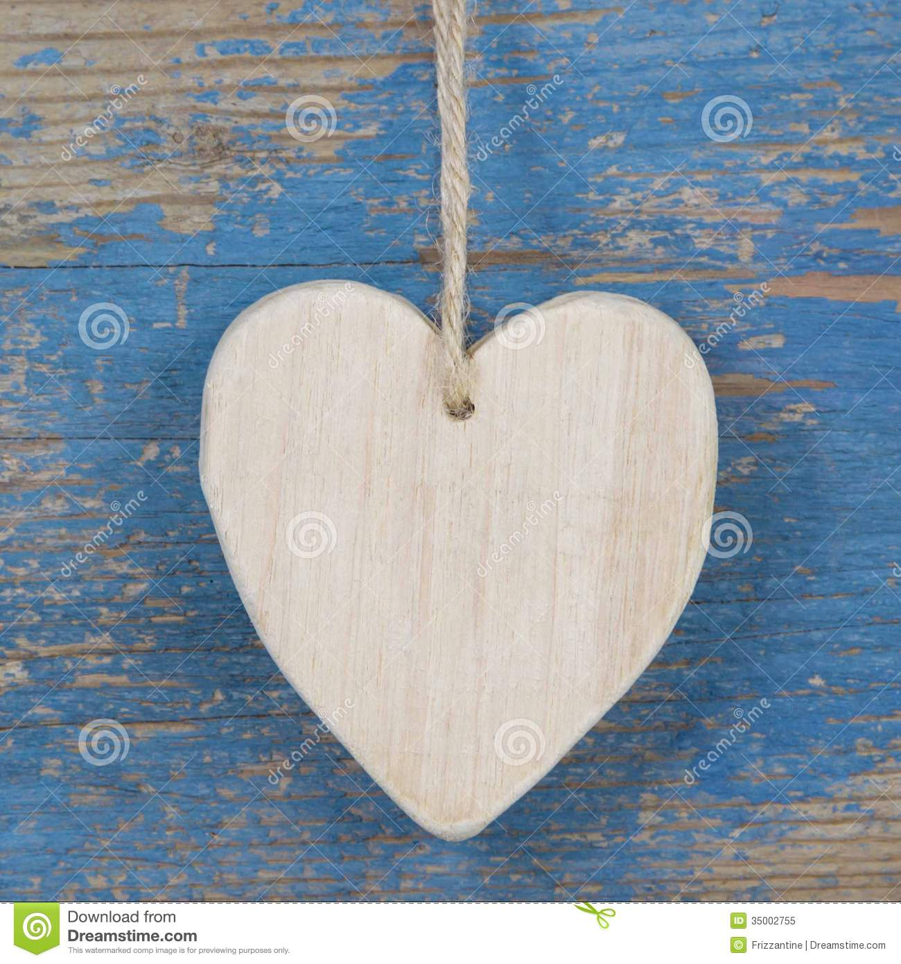 Wooden Heart Shape On Blue Wooden Surface For Valentine Birthda Royalty Free Stock Photo