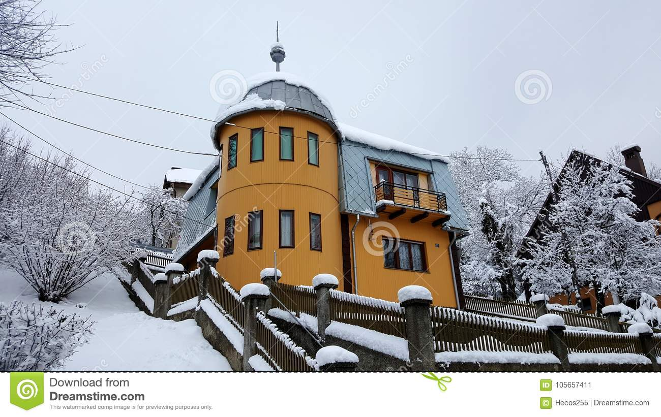 Wooden House With Tower Covered In Snow Stock Image