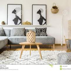 Cushions Living Room Dresser Wooden Table On Carpet In African Interior With Patterned Grey Sofa
