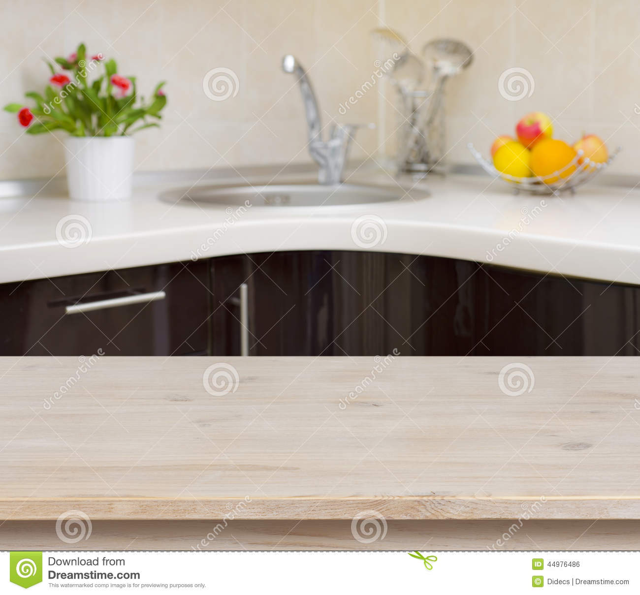 3 hole kitchen faucet ventless hood wooden table on interior background stock ...