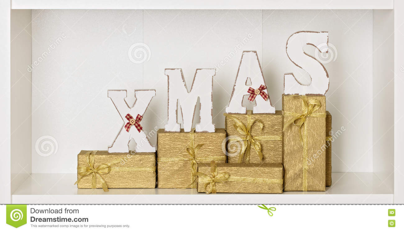Download Wooden White Xmas Letters On A White Background With Packed Gift  Stock Photo - Image