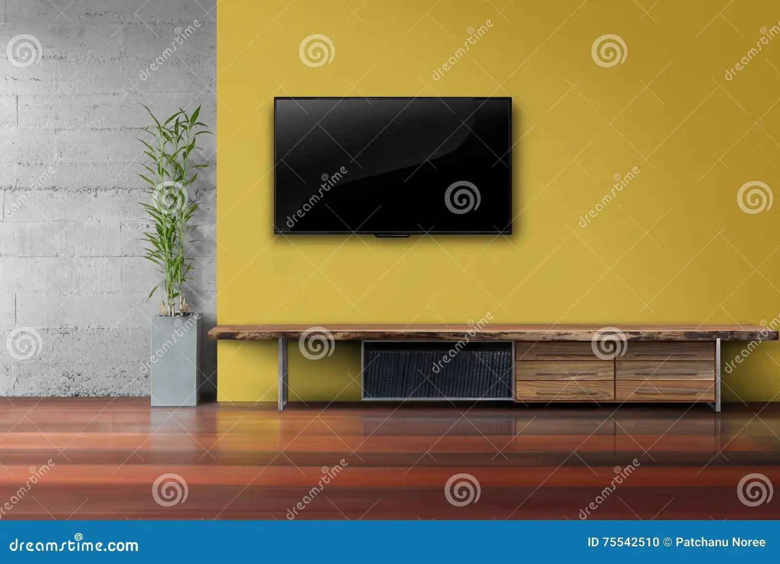Woonkamer Geleide TV Op Gele Muur Met Houten Lijstmedia