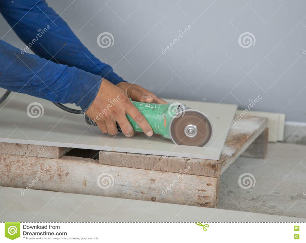 worker cutting a tile using an angle grinder stock image image of cutting hand 71992385