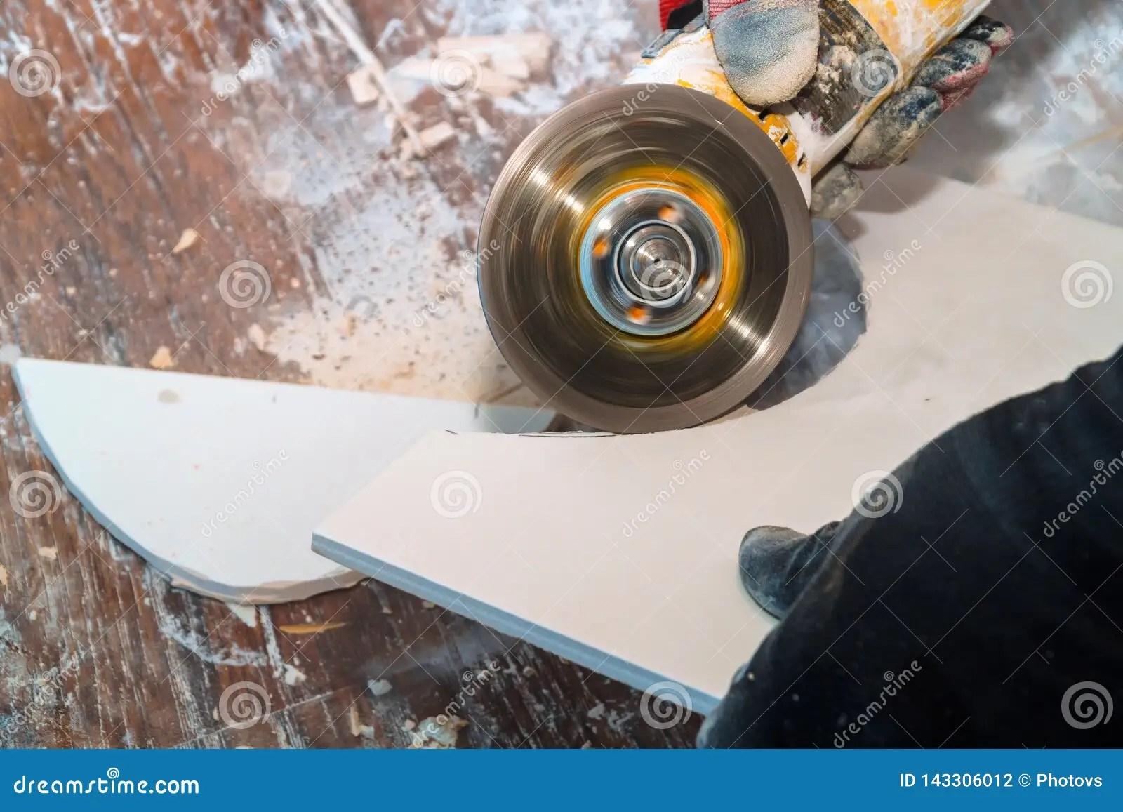 https www dreamstime com worker cutting tile using grinder cut layers ceramic floor tiles image143306012