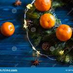 Wreath Made From Fresh Mandarins With Leaves And Spruce Branches With Cones On Navy Rustic Wooden Table With Garland And Star Anis Stock Image Image Of Clementine Creative 128714603