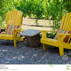 2 X 4 Adirondack Chair Plans Wheelchair Quotes Yellow Chairs On A Patio Stock Image