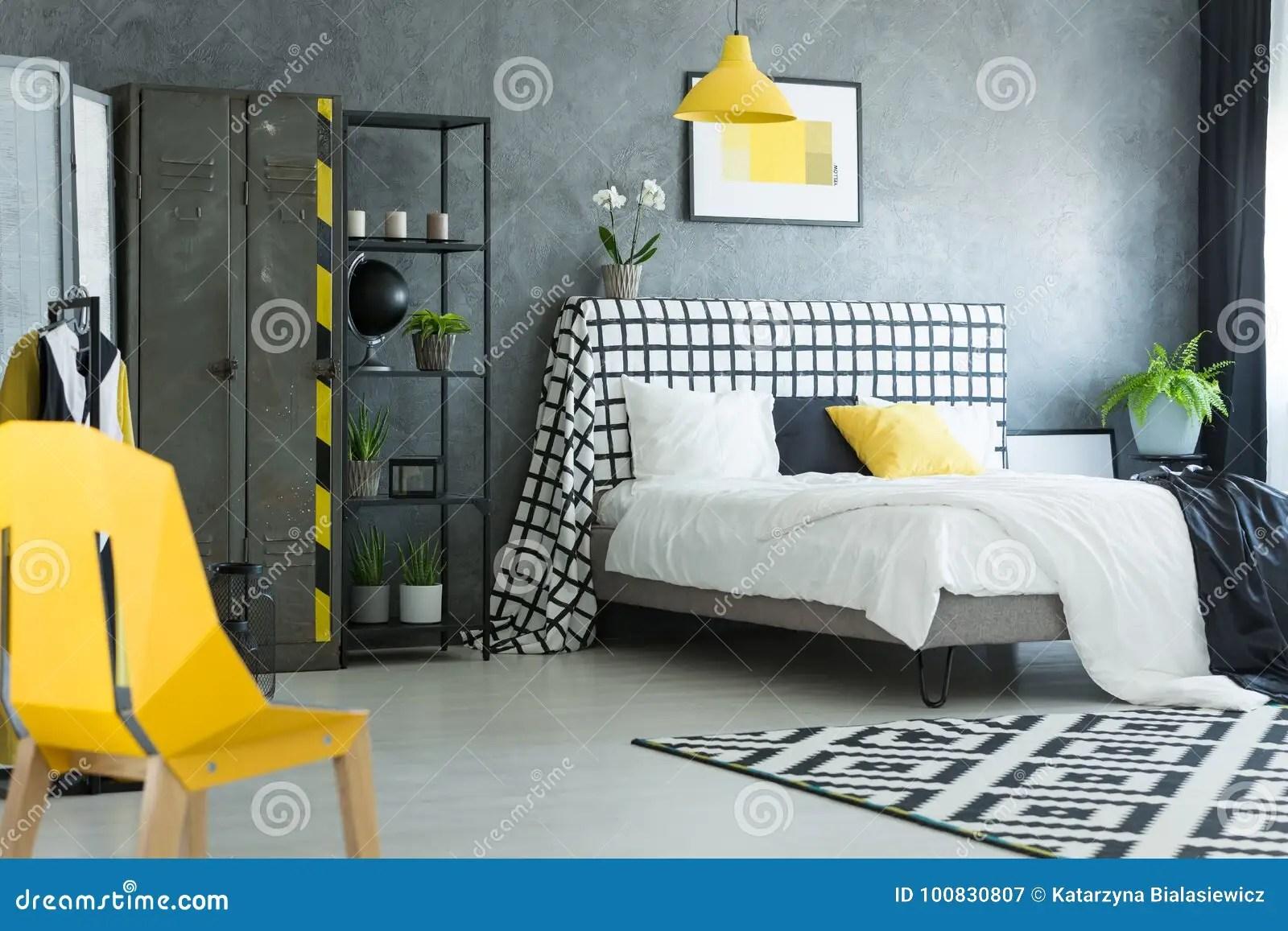 https www dreamstime com yellow designer chair bedroom yellow designer chair black white bedroom geometric carpet metal shelf image100830807