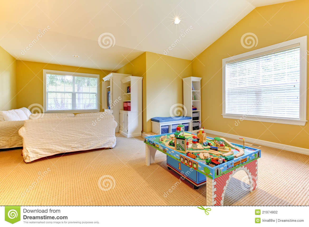 children s playroom sofa under storage trays yellow kids play room with white stock photography