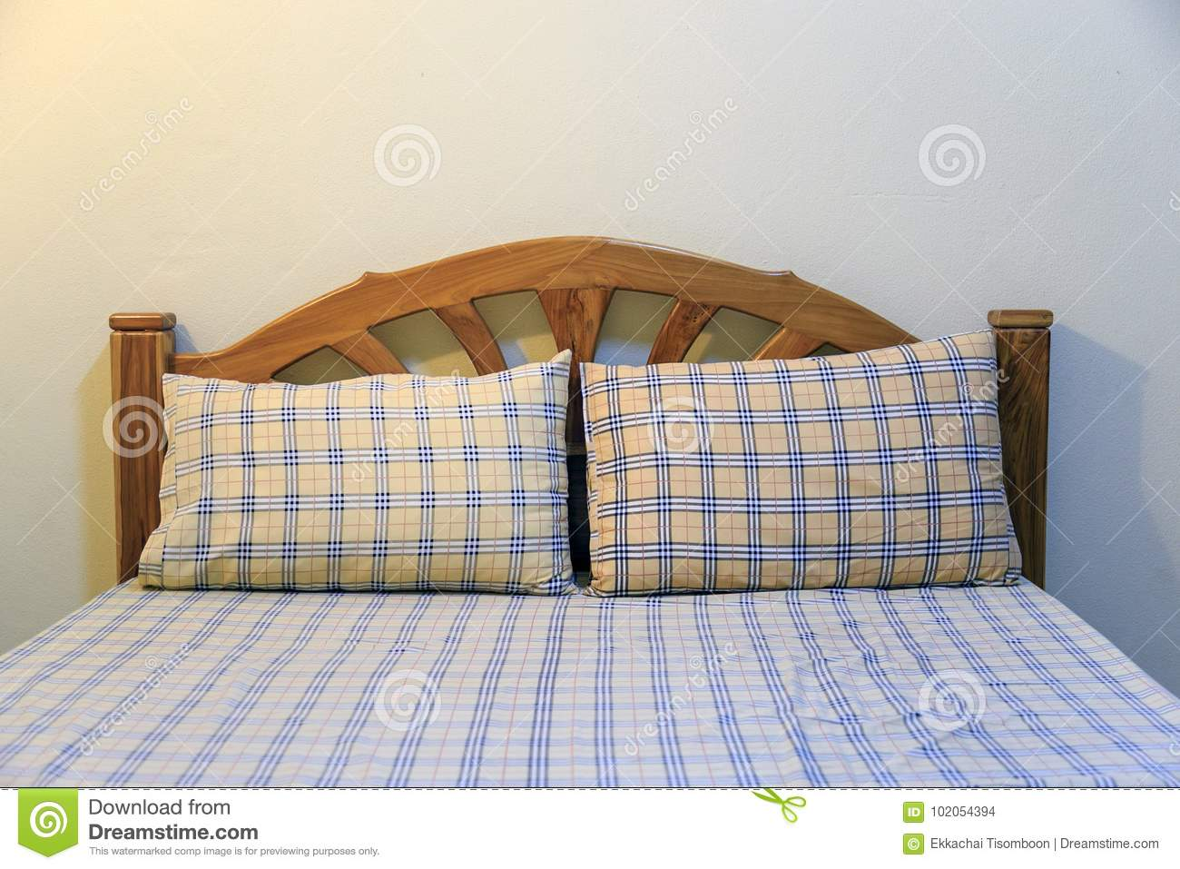 Yellow Pillow With Square Pattern On Mattress In Economy