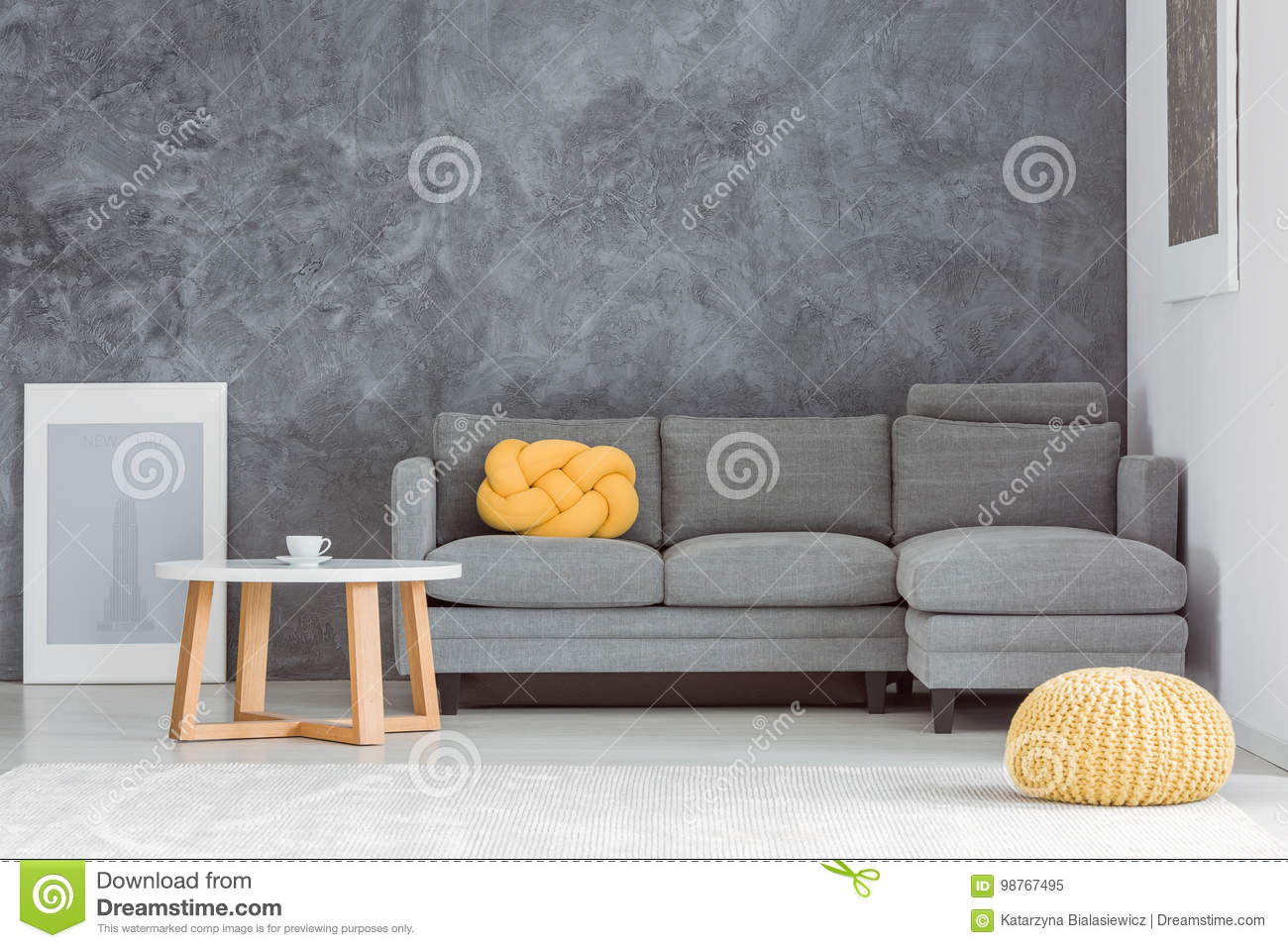 pouf in living room couch images yellow stock image of flat 98767495 front grey sofa against concrete wall with designed coffee table