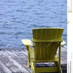 New River Adirondack Chairs Unusual Dining Chair Yellow Wood On A Dock Over Water Stock