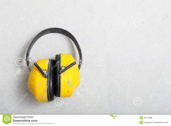 Yellow Protective Ear Muffs In Hand Isolated White