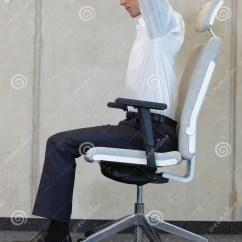 Ergonomic Yoga Chair Folding For Bathroom On In Office Business Man Exercising Stock Image