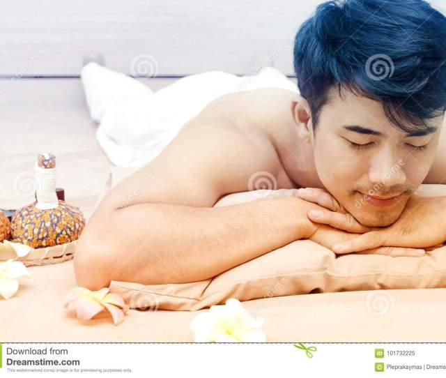 Asian Man Relaxing On Massage Desk