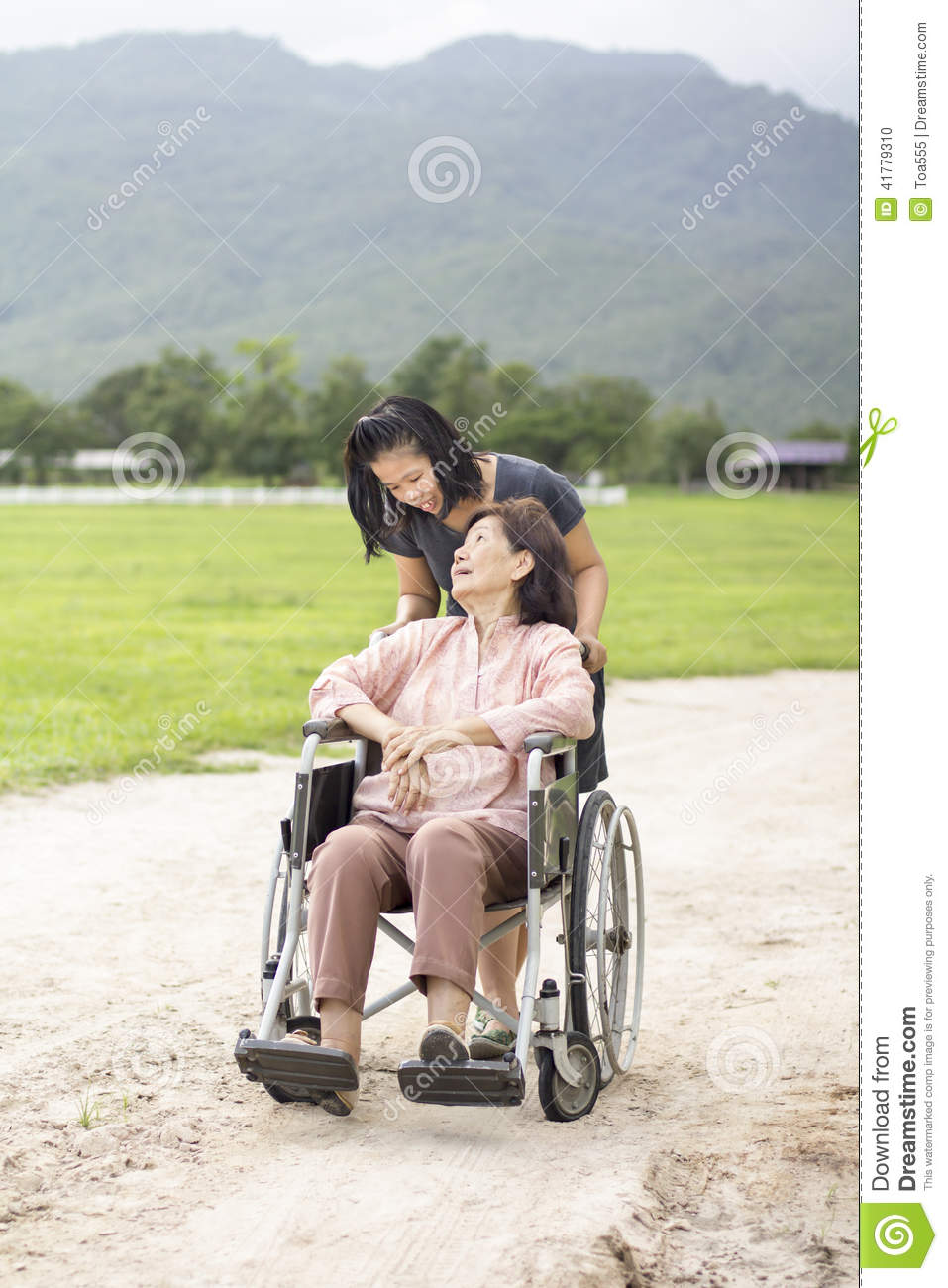 Young Asian Is Taking Care The Senior Woman With