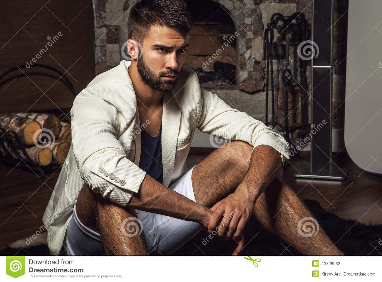 Young Attractive Bearded Men In White Suit Pose In Modern