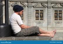 Young Barefoot Man Listen Music Editorial