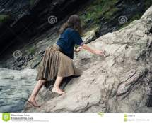 Women Rock Climbing Barefoot