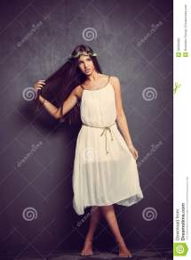 Young Barefoot Woman In White Dress Stock