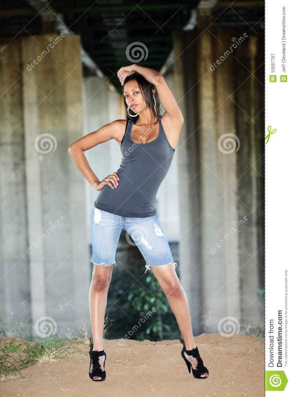 Young Black Woman In Jeans Cutoff Shorts Stock