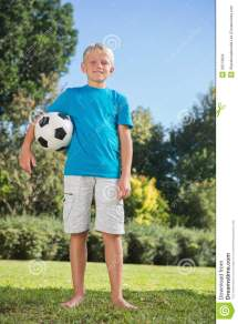 Young Blonde Boy Holding Football Stock