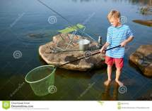 Young Boy Fishing Summer Lake Stock - 88474762