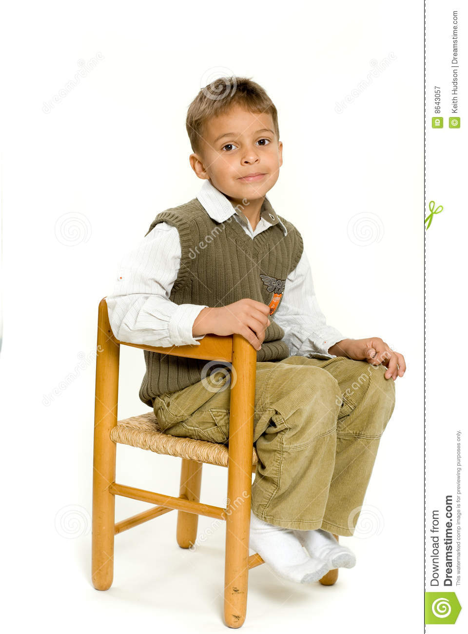 Young Boy Sitting In Chair Royalty Free Stock Photography