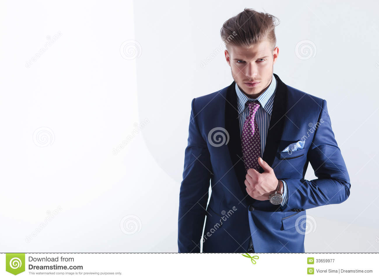 Young Business Man With Hand On Jacket Lapel Stock Image