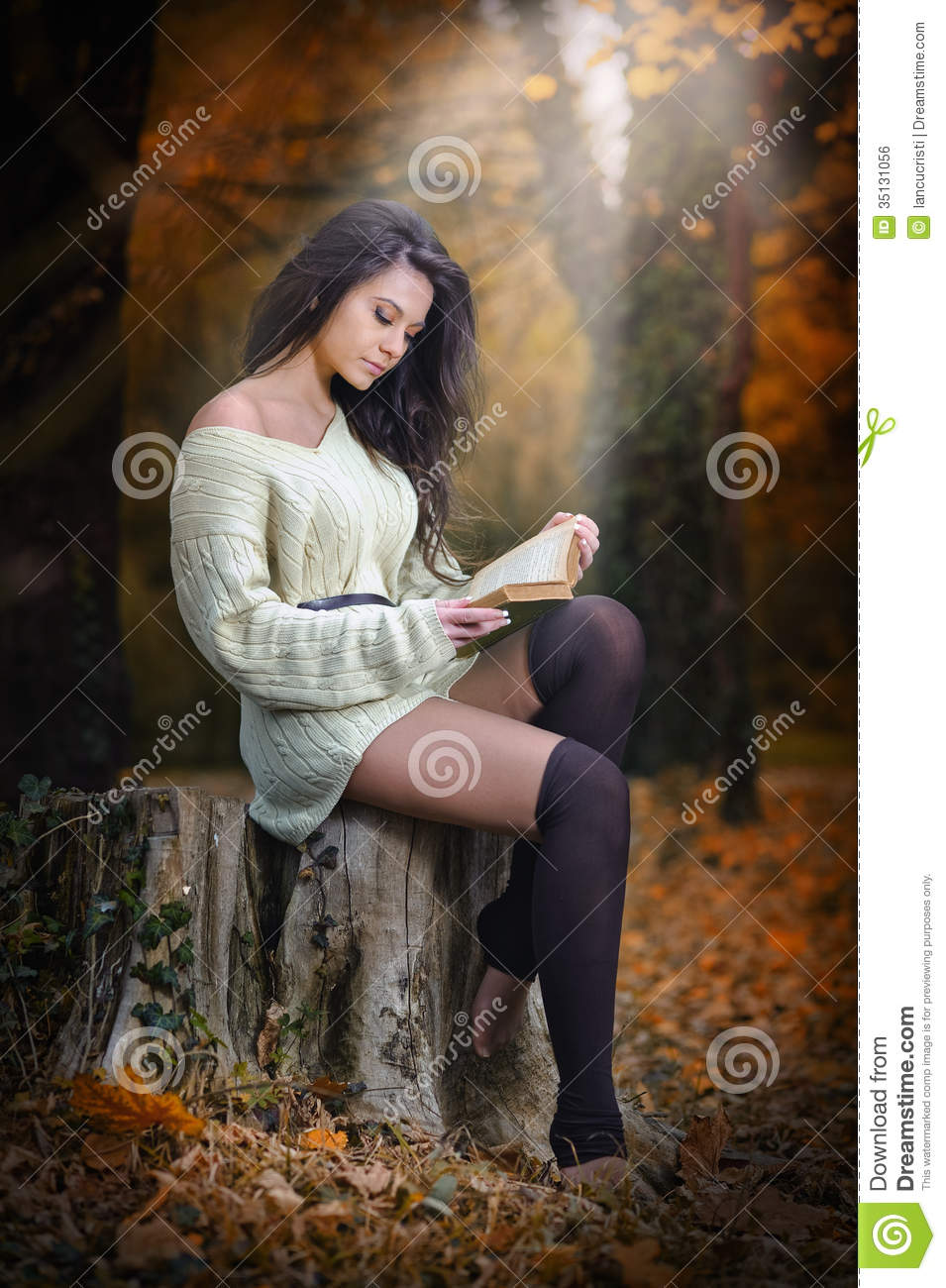 Young Caucasian Sensual Woman Reading A Book In A Romantic