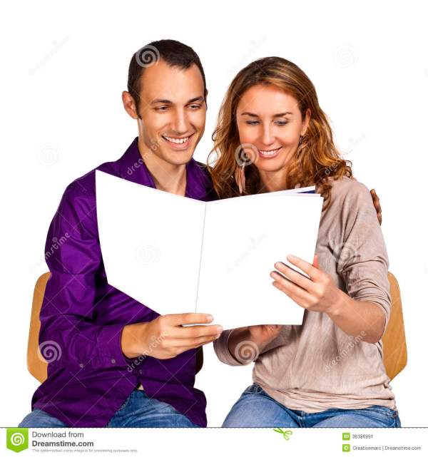Young Couple In Love Reading Brochure Stock