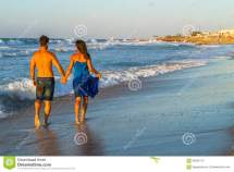 Young Couple Walking Barefoot Wet Beach Stock