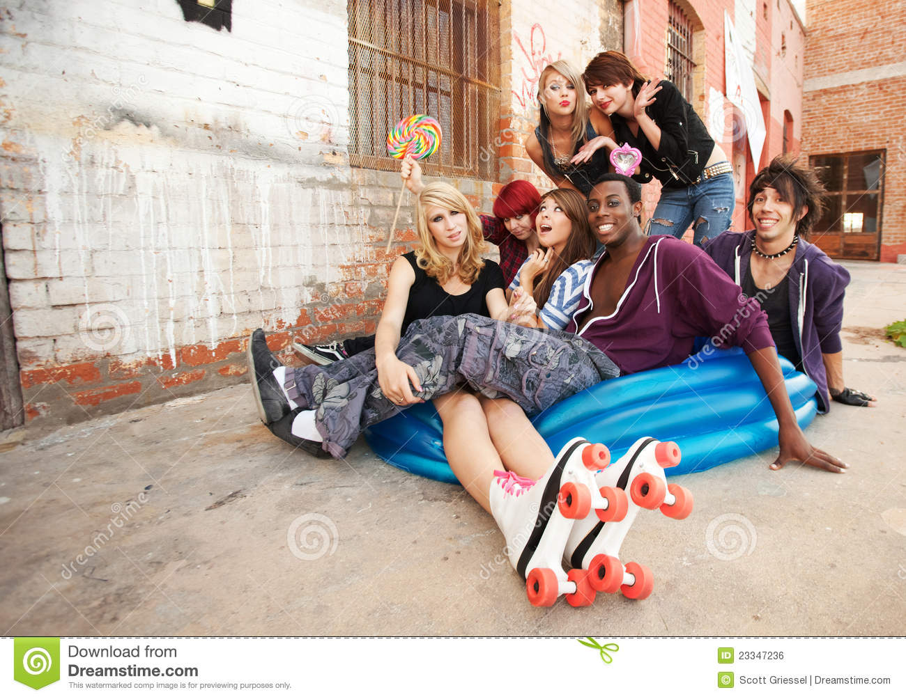 Young And Crazy Teens Playing Stock Photo