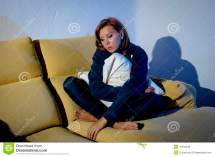 Person Sitting Alone On Couch
