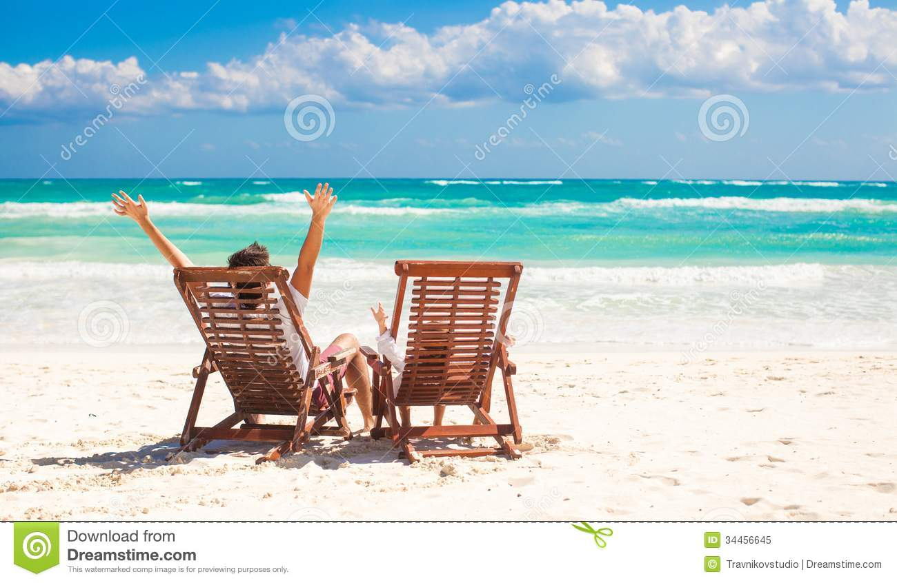 Young Father With Little Daughter In Beach Chairs Royalty